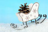 Christmas decoration in shape sled on light blue background