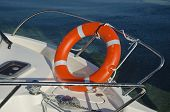 picture of life-boat  - orange life buoy on yacht sailing boat - JPG