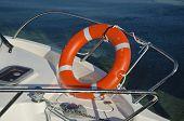 Orange Life Buoy On Yacht