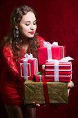 Beautiful Girl Holding Gifts.