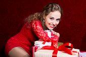 Beautiful Girl Hugging Gift Hand And Smiling.