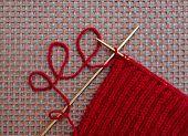 picture of knitting  - Handmade maroon knitting yarn with knitting needles - JPG