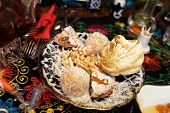 picture of middle eastern culture  - Middle eastern desserts on a plate in the uzbek restaurant - JPG