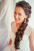 image of panty-hose  - Beautiful young bride with wedding makeup and hairstyle in bedroom newlywed woman final preparation for wedding - JPG