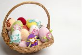 stock photo of boll  - Easter egg made of multicolored crochet yarn on a white background with bolls skeins and crochet hooks - JPG