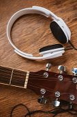 pic of bluegrass  - acoustic guitar and headphone on fabric sofa  - JPG
