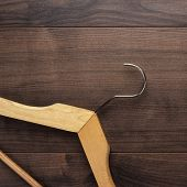 picture of clothes hanger  - clothing hanger on the brown wooden table - JPG