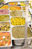 picture of pickled vegetables  - Many different sorts of pickled vegetables on a street market stall - JPG