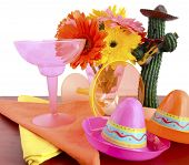 image of gerbera daisy  - Happy Cinco de Mayo bright colorful party table place setting with bright gerbera daisy flowers on distressed red wood table - JPG