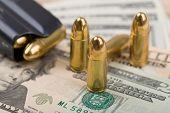 pic of corruption  - detail of bullet on US dollar banknotes crime or corruption concept - JPG