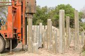 image of piles  - pile driver driving precast concrete piles on a construction site - JPG