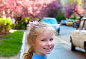 Happy Small Girl Portrait And Blossoming Japanese Cherry Tree