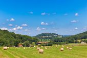 stock photo of hay bale  - Round bales of hay on French farmland - JPG