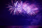 stock photo of firework display  - Blue colorful fireworks on the black sky background
