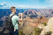 foto of memento  - Tourist man taking photo of Grand Canyon - JPG