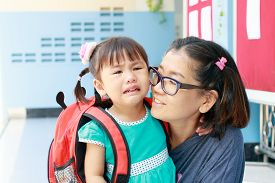 image of cry  - children and mother crying first day go to pre-kindergarten school ** Note: Shallow depth of field - JPG