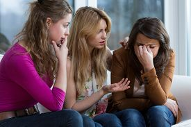 picture of cry  - Two young worried girls supporting crying friend  - JPG
