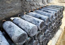 picture of wine cellar  - The ancient bottles of wine in the ancient cellar - JPG