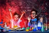 Funny little children doing experiments in the laboratory. Explosion in the laboratory. Science and  poster