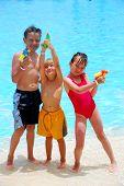 Three Kids With Squirt Guns