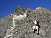pic of mountain-climber  - climbing a rocky ridge on way to the summit of a 14er - JPG