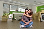 Young couple happy after moving in their new home. The images of the pictures are mine, and the labe