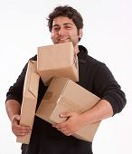 Portrait of a young man struggling with lots of parcels