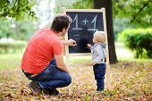 Father And His Son Practicing Mathematics poster