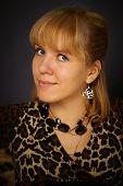Portrait Of Beautiful Woman In Leopard Dress
