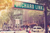 Street Sign Or Traffic Sign Of Orchard Road. The Famous Shopping Main Street Orchard Road Area In Si poster