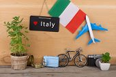 Blackboard With Text italy, Flag Of The Italy, Airplane Model, Little Bicycle And Suitcase, Camera poster