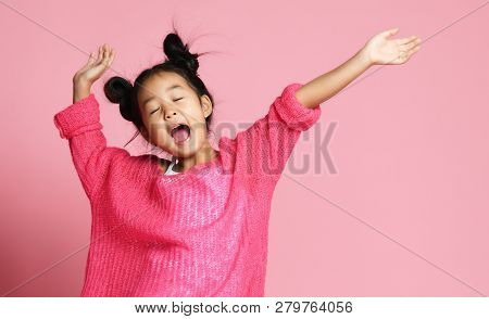poster of Asian Kid Girl In Pink Sweater, White Pants And Funny Buns Sings Singing Dancing On Pink Background