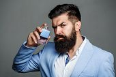 Man Perfume, Fragrance. Masculine Perfume. Male Fragrance And Perfumery, Cosmetics. Bearded Man Hold poster