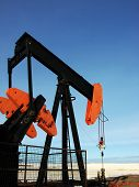 stock photo of nonrenewable  - A pump jack stands alone on the prairies - JPG