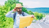 Pick Up Local Map. Tourist Backpacker Looks At Map Choosing Travel Destination At Road. Around The W poster