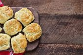 Fresh Buttermilk Southern Biscuits Or Scones Over A Rustic Wooden Table Shot From Above. Top View. poster