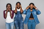 Three African Woman In Casual Clothes Showing Blind, Deaf And Dumb: Wise Monkey Scene - Hear No Evil poster
