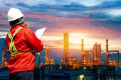 Engineering Man With White Safety Helmet Standing In Front Of Oil Refinery Building Structure In Hea poster