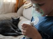 Teen Makes Inhalation With Mask Nebulizer poster