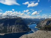 Popular Tourist Attraction Near Trolltunga In Sunny Weather. View From The Trolltunga Trail. Mountai poster