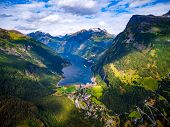 Geiranger fjord, Beautiful Nature Norway. It is a 15-kilometre (9.3 mi) long branch off of the Sunny poster