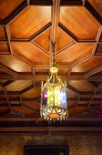 Ceiling Lamps Are Made Of Colorful Glass In Vintage Style On The Wooden Ceiling poster
