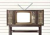 Old Retro  Wooden Home Tv Receiver  On Old Wood Table On White Wood Wall/ Old  Television On Old Tab poster