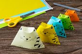 Origami Toy Made From Paper Puppets Cat. Glue, Scissors And Paper On A Wooden Table. Childrens Art  poster