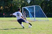 Soccer Player Against Goalie