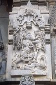 stock photo of belur  - Sculpture of Ganesha gleefully dancing holding amours in his hands at Channakeshava Temple Belur Karnataka India Asia - JPG