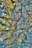 Wall Of Bassalt Rock With Cracks