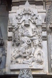 foto of belur  - Sculpture of Ganesha gleefully dancing holding amours in his hands at Channakeshava Temple Belur Karnataka India Asia - JPG