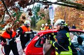 Accident - Fire brigade rescues accident Victim of a car using a hydraulic rescue tool and giving a