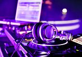 picture of mixer  - Dj mixer with headphones at a nightclub